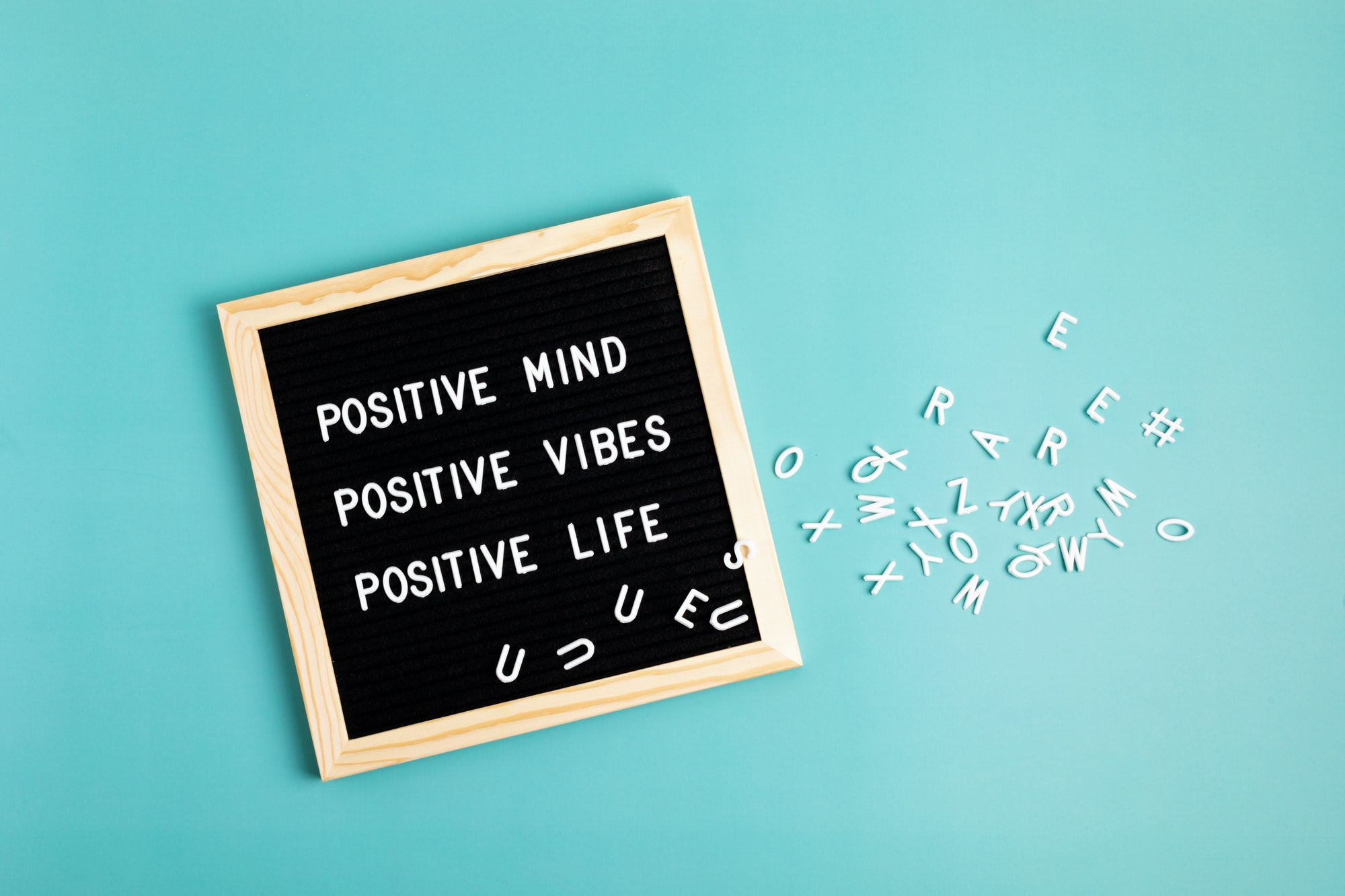 Positive mind, positive vibes, positive life motivational quote on the letter board. Inspiration